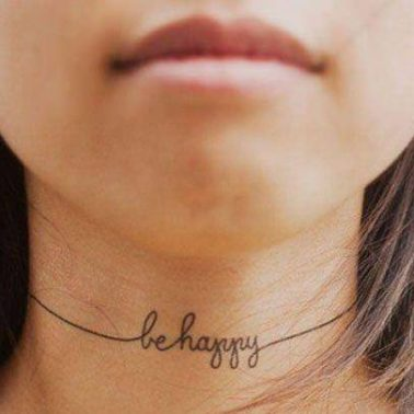 A script tattoo that reads 'be happy' on the neck