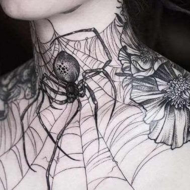 A blackwork neck and chest tattoo of a spider weaving its web