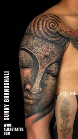 A large half-sleeve coverup tattoo featuring the Buddha