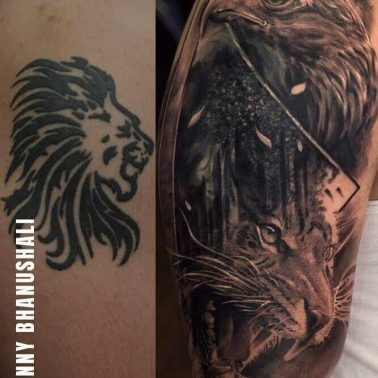 A large blackwork and realism coverup tattoo over a small simple lion tattoo