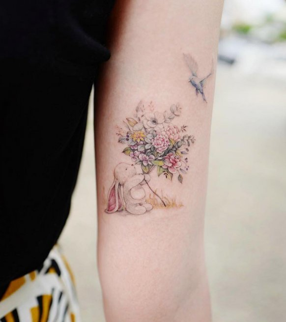 Rabbit Floral Bird Bicep Tattoo