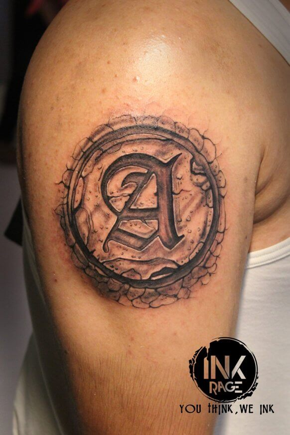 Abstract Letter Tattoo