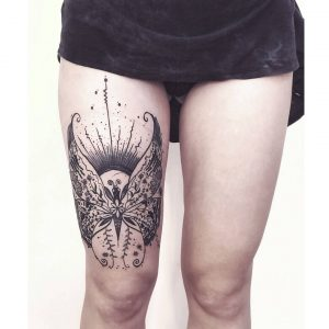 Abstract Butterfly Thigh Tattoo