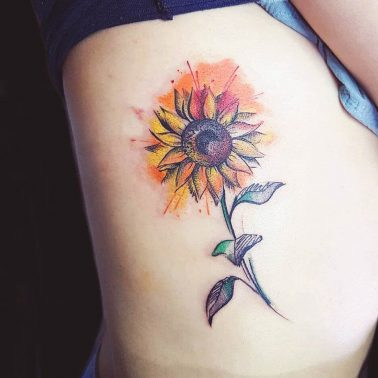 Water Colour sunflower rib tattoo