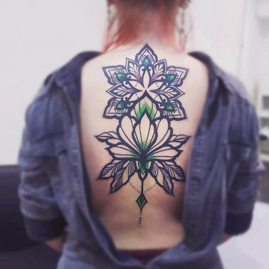 Geometric floral ornamental back tattoo