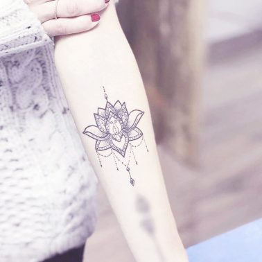 Floral Ornamental Hand Tattoo