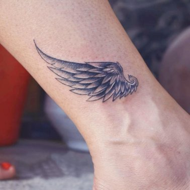 Minimalist Angel Wing Tattoo