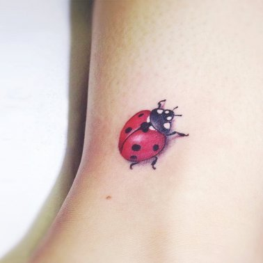 Minimalistic,Realist Lady Bug Tattoo