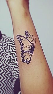 Minimalistic Butterfly Tattoo