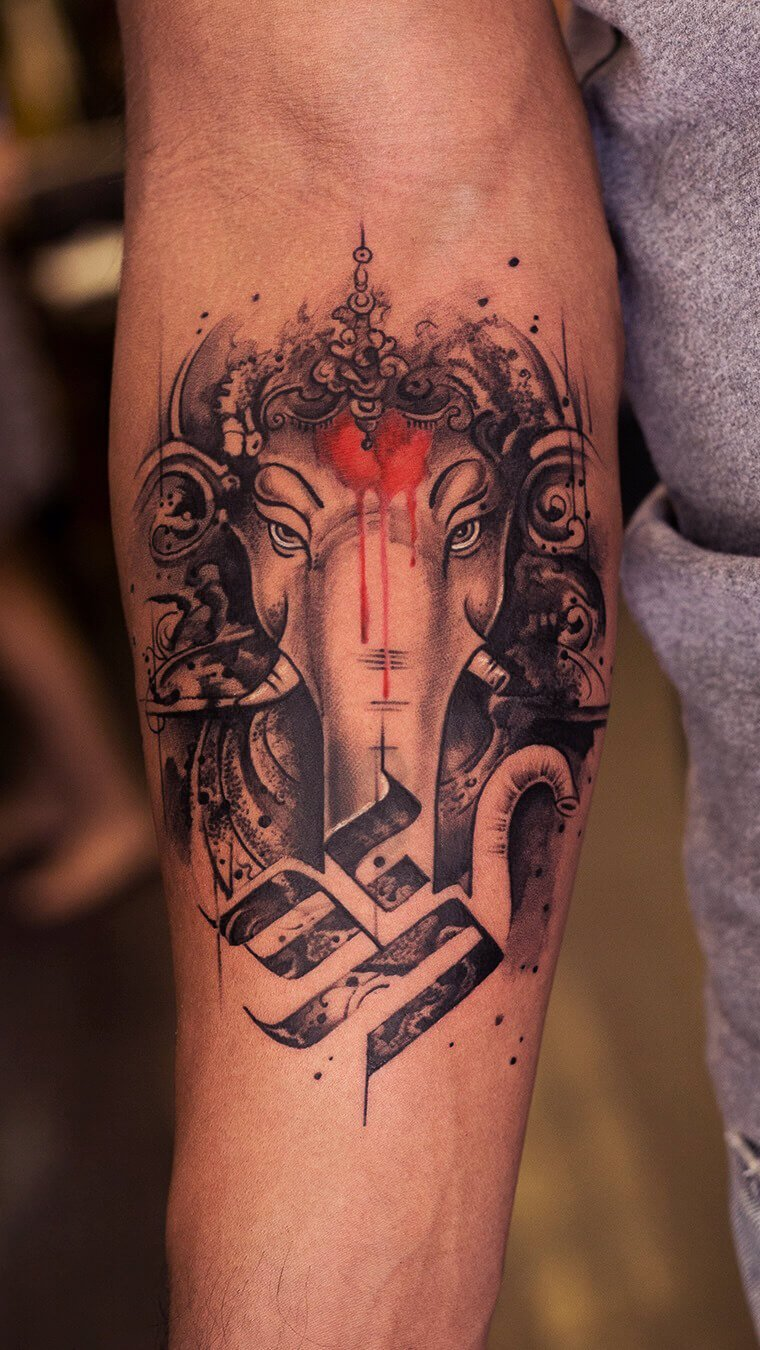 Lord Ganesha Arm Tattoo