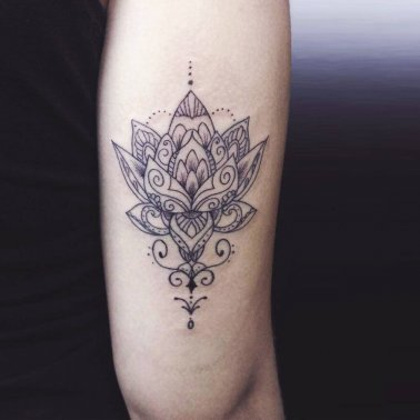 Above elbow floral tattoo