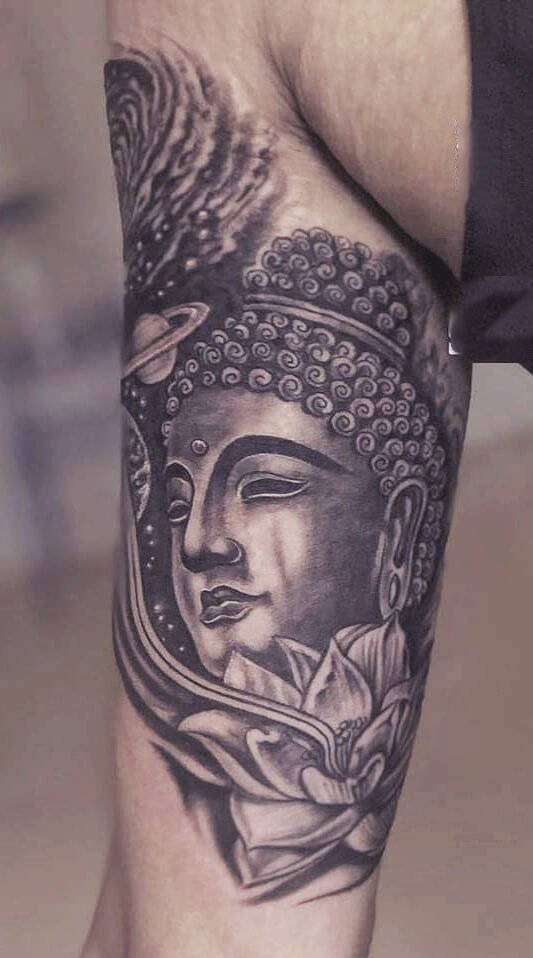 buddha tattoo in hand